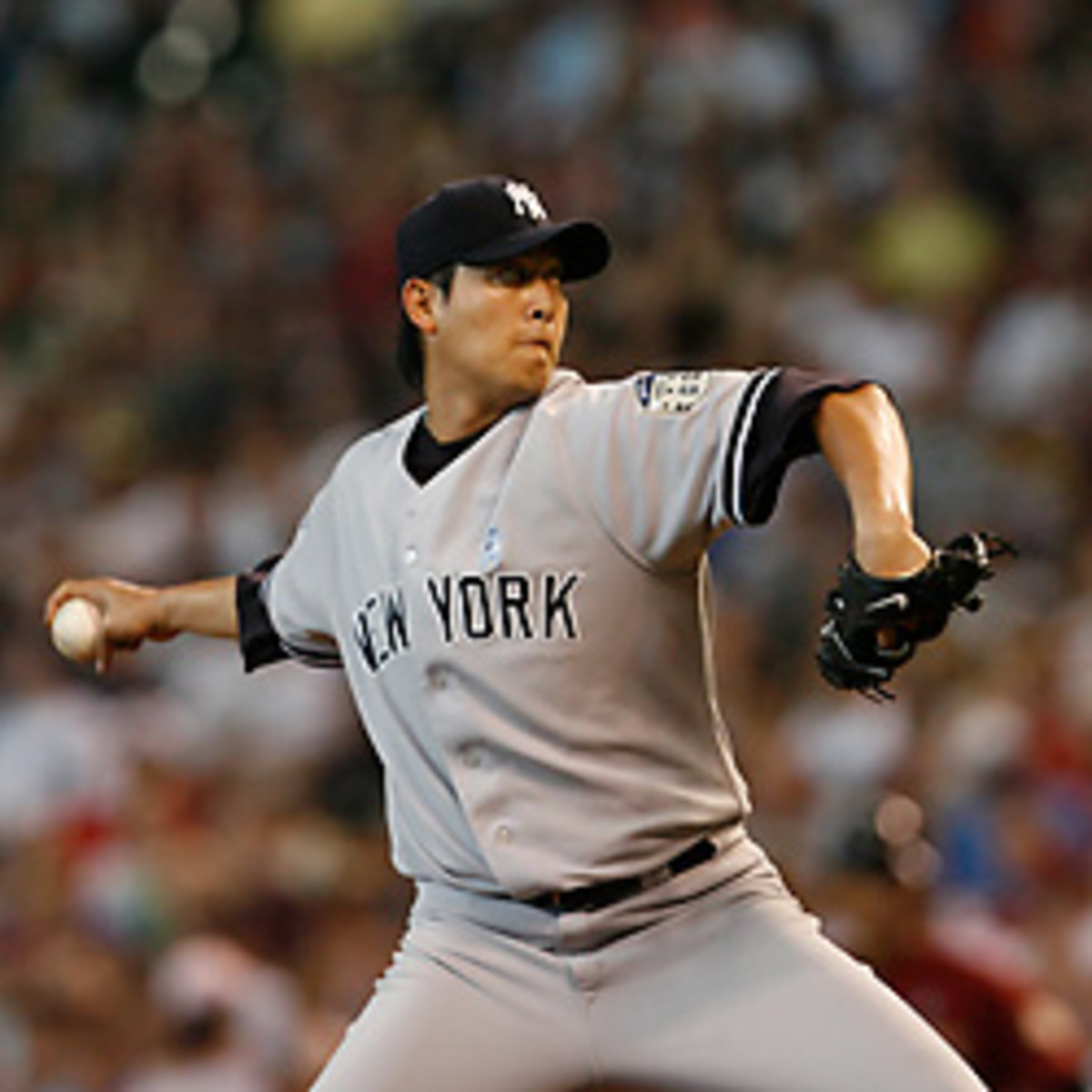 Chien-Ming Wang will return to the Yankees after agreeing to terms. [Aaron M. Sprecher/Icon SMI]
