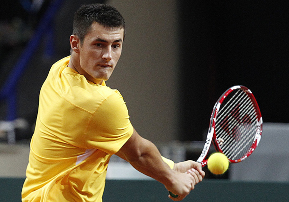 Bernard Tomic played against Lukasz Kubot in their Davis Cup play-off. (Czarek Sokolowski/AP)