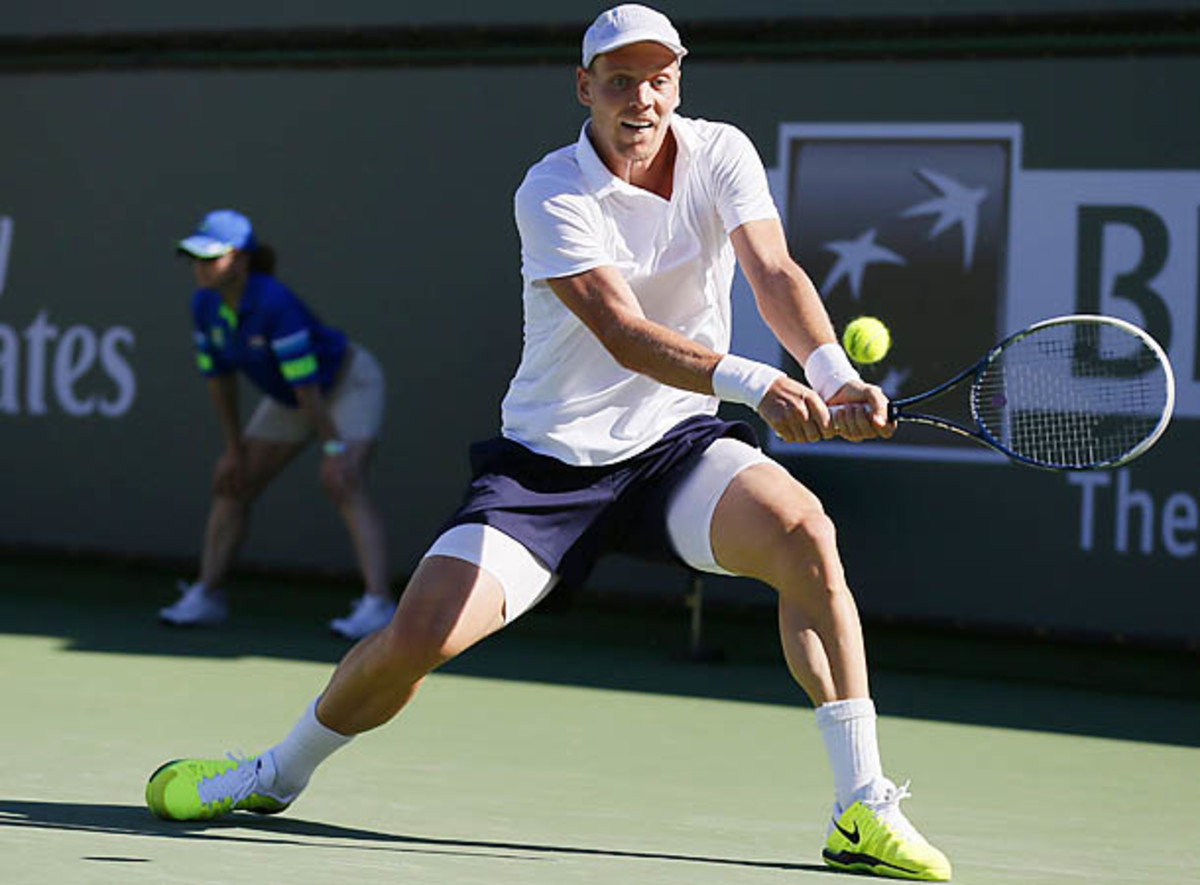 Tomas Berdych of the Czech Republic returns a shot against Florian Mayer of Germany at the BNP Paribas Open ATP tennis tournament in Indian Wells, California