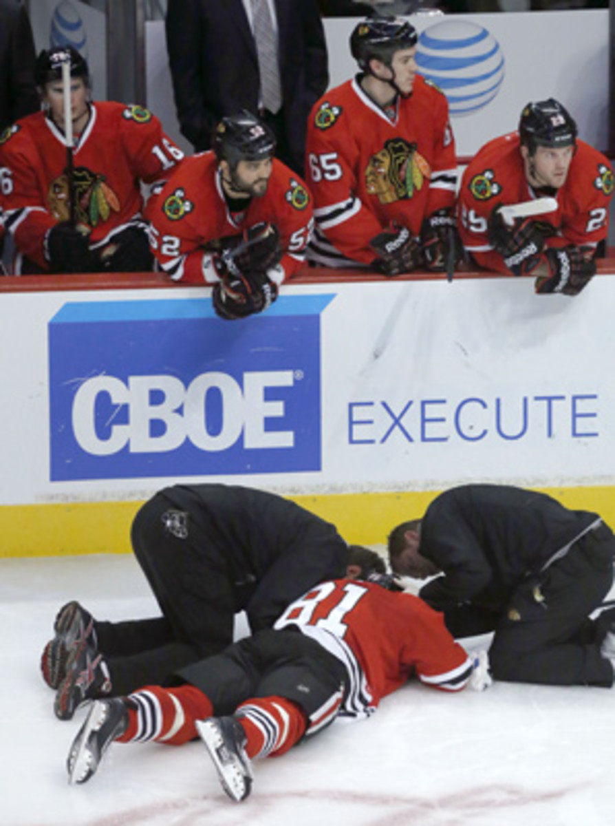 Marian Hossa (81) was knocked out of the game by Jannik Hansen on Wednesday.