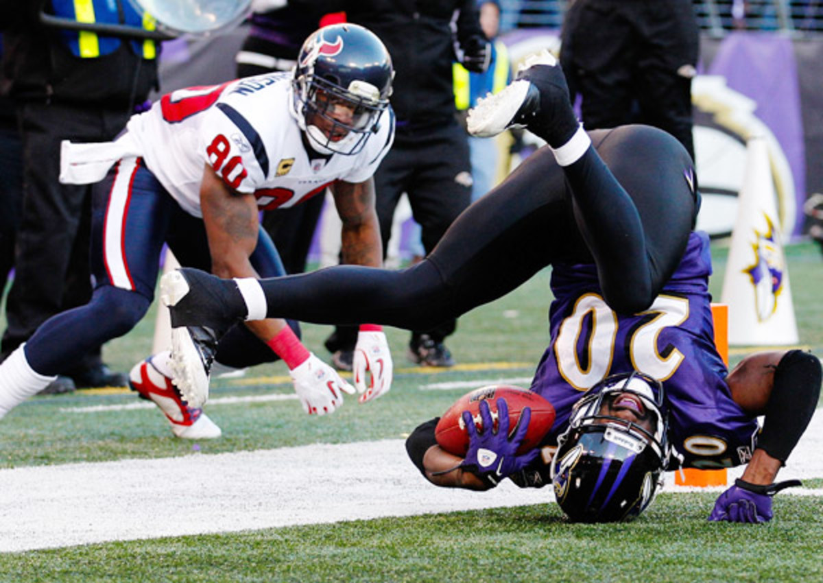 On Sunday, the Texans' Ed Reed (right) returns to Baltimore, where he spent 11 seasons.