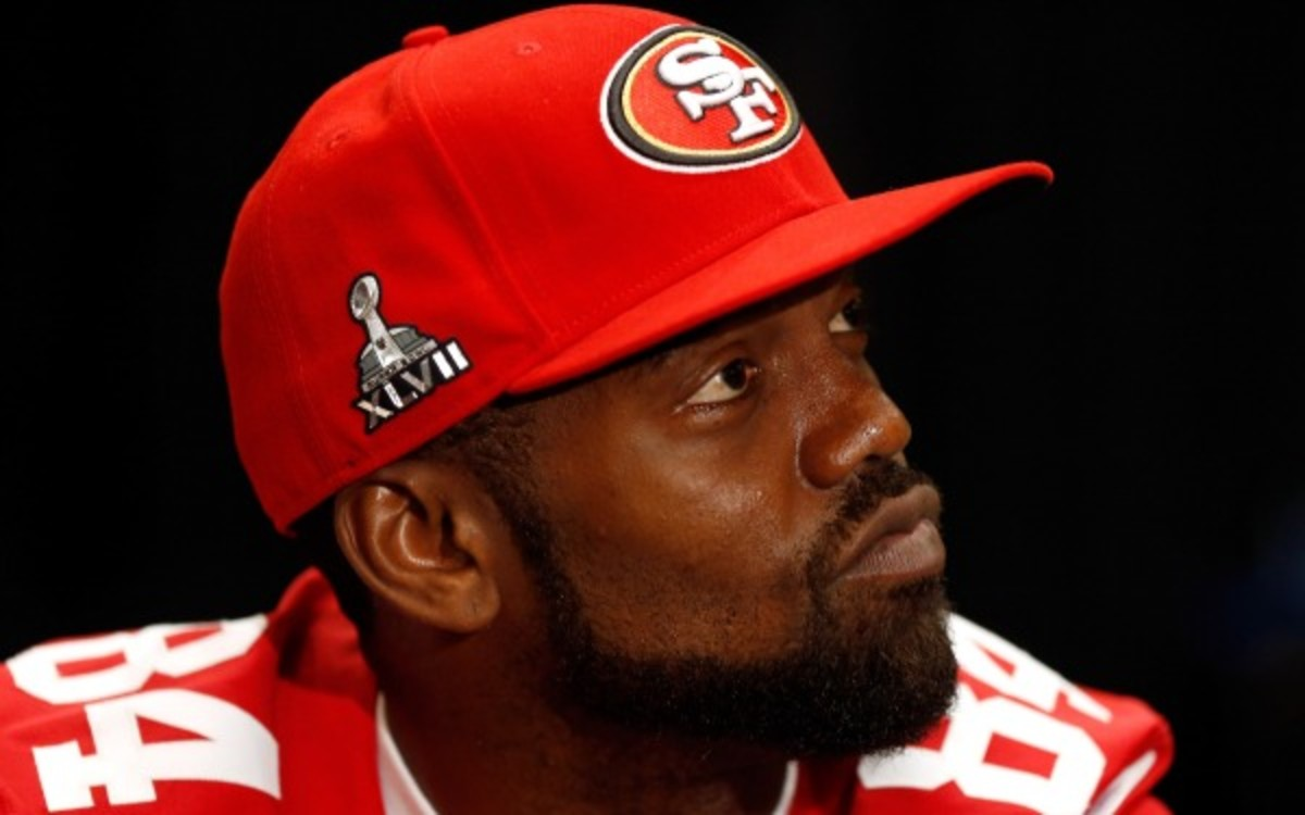 49ers coach Jim Harbaugh has no plans to bring back Randy Moss right now. (Scott Halleran/Getty Images)
