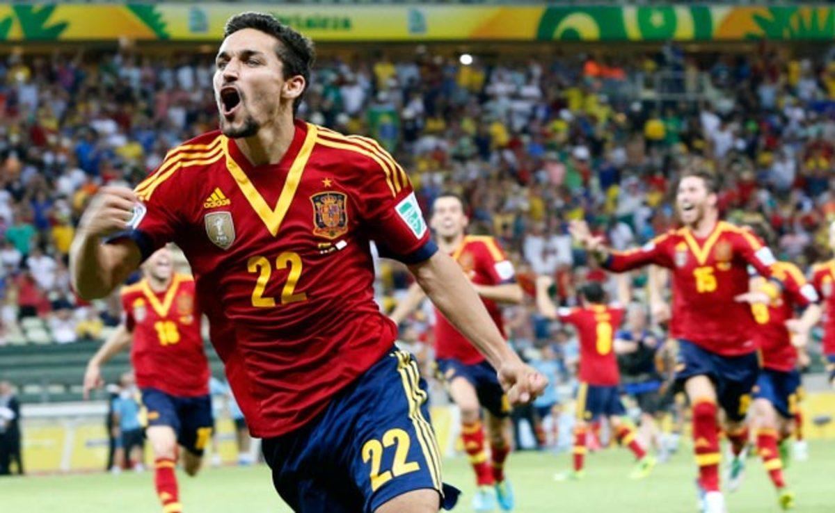 Jesus Navas celebrates after scoring the decisive penalty kick to defeat Italy on Thursday.