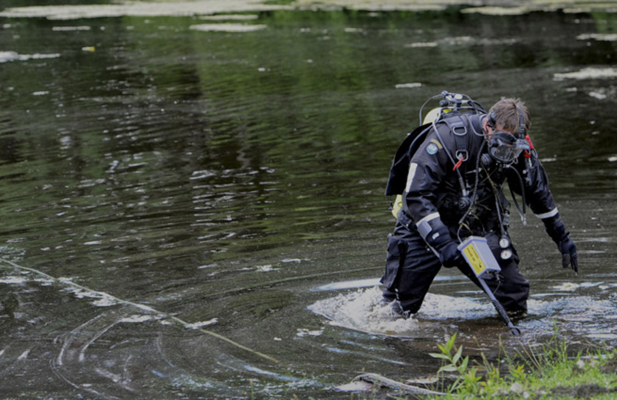Police divers searched a pond in the hometown of Aaron Hernandez on Monday.