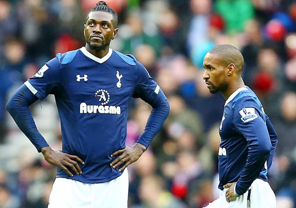 Emmanuel Adebayor (left) looks on next to Jermain Defoe during a Tottenham Hotspur match.