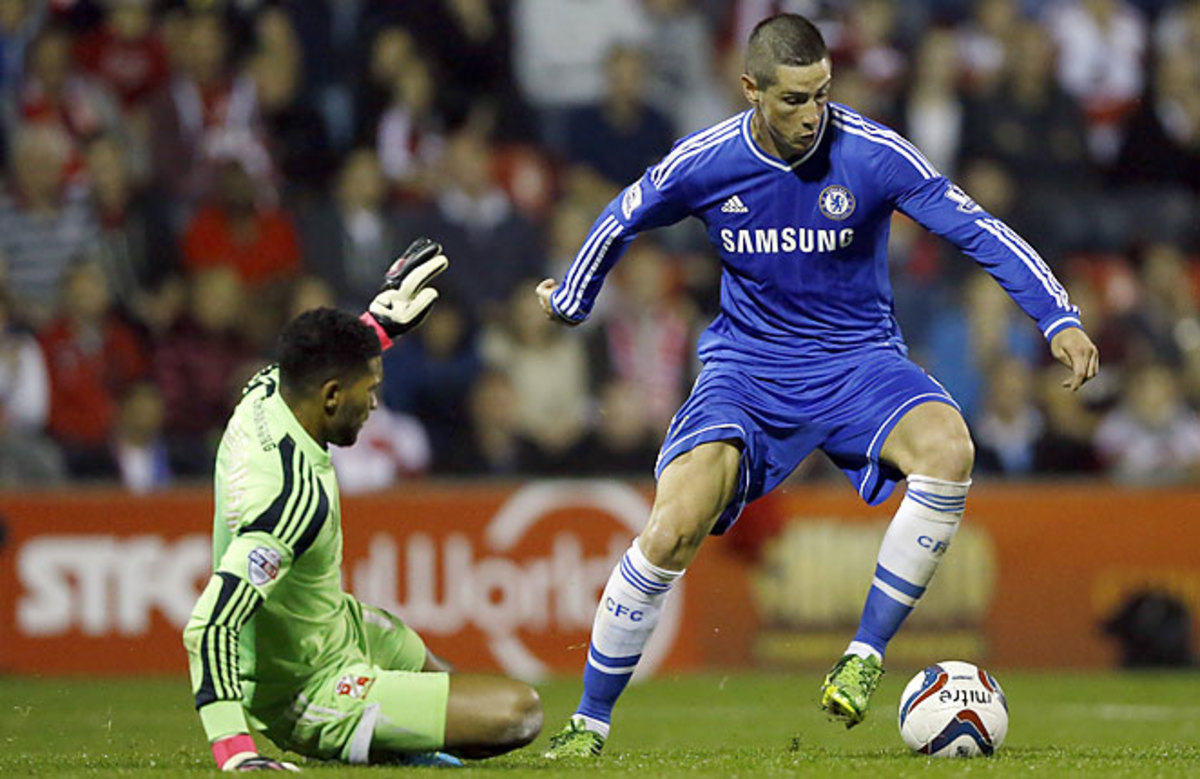 Fernando Torres scored a goal and set up another one as Chelsea cruised to a League Cup win over Swindon Town.