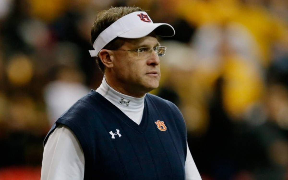 Gus Malzahn's offense lead the NCAA in rushing offense averaging 335 yards a game. (Kevin C. Cox/Getty Images)