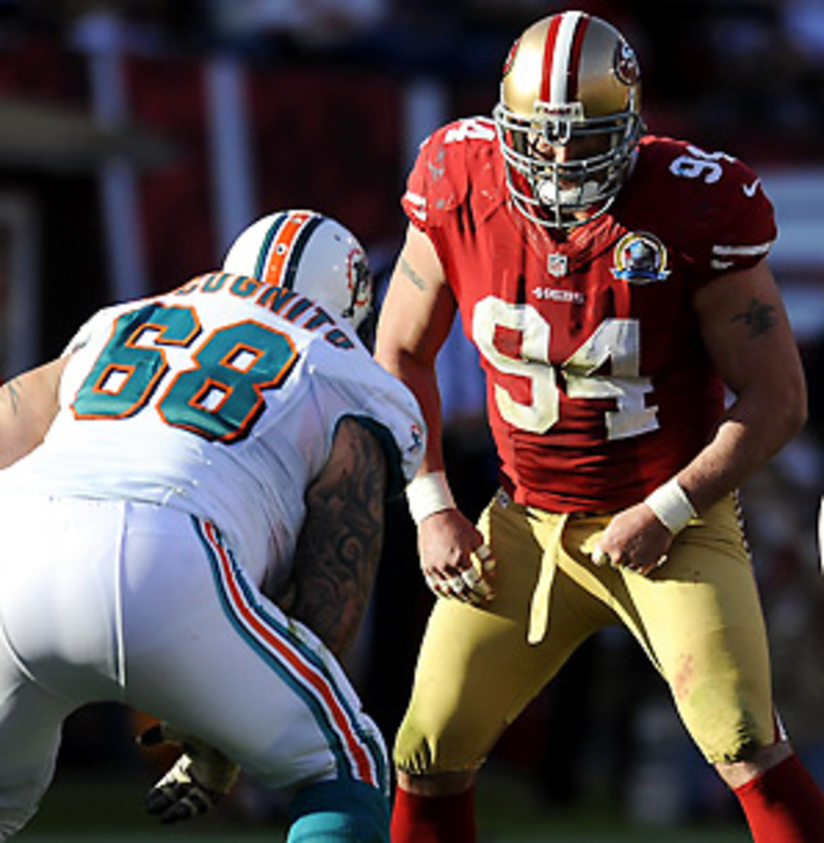 The 49ers' Justin Smith reportedly has a partially torn triceps. (David Welker/Getty Images)