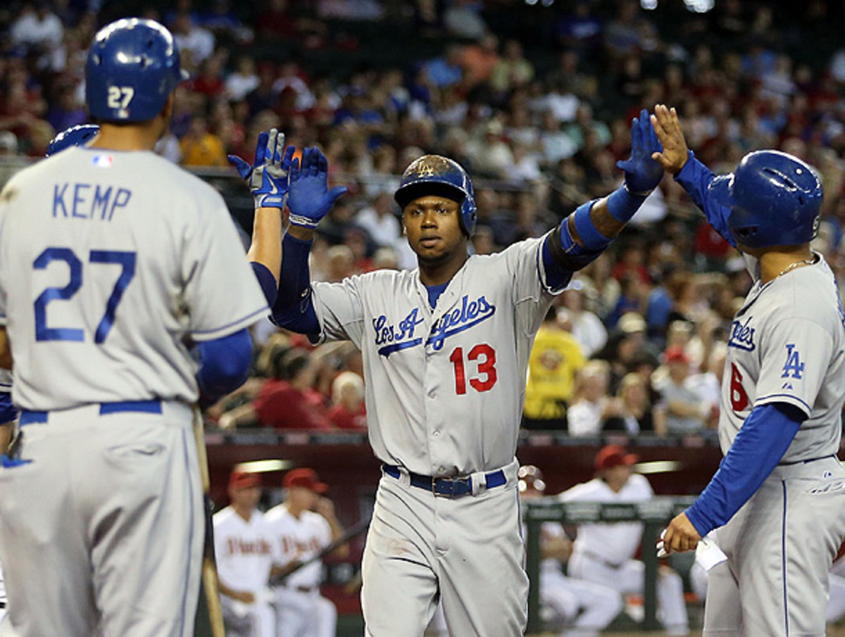 Hanley Ramirez (13) slugged two homers during the Dodgers' division-clinching victory. (Christian Petersen/Getty Images)