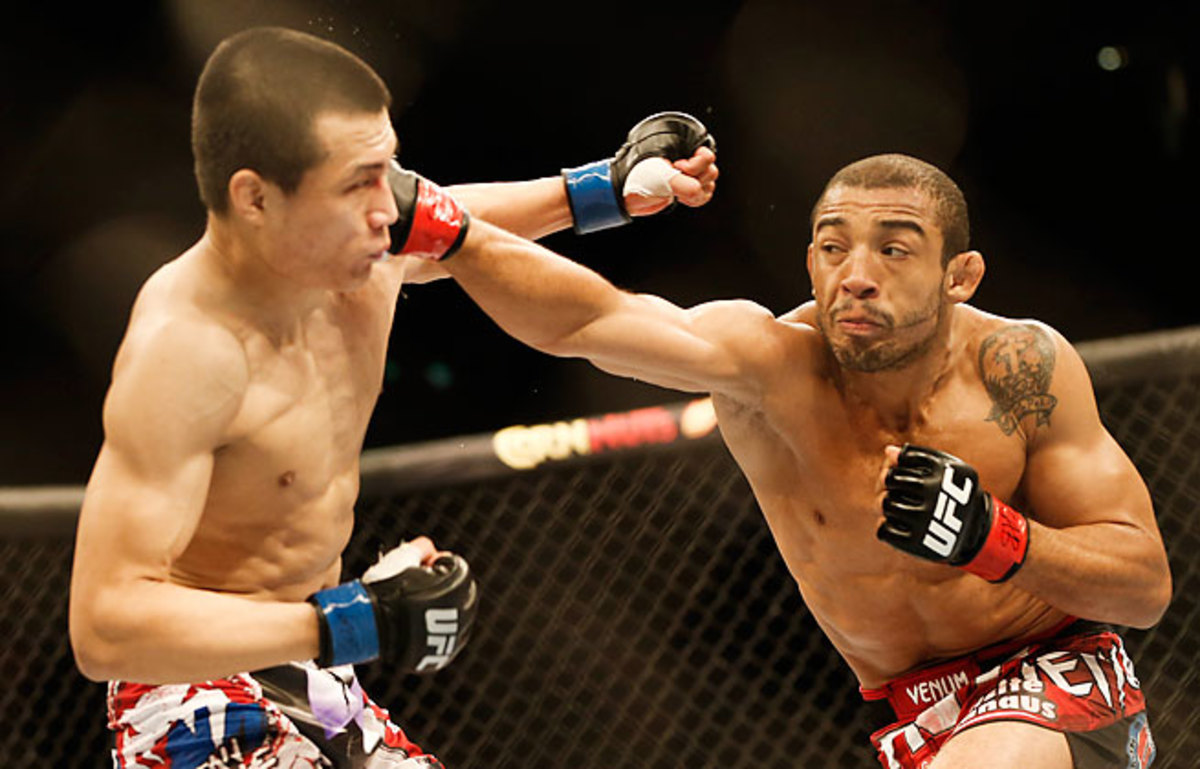 José Aldo scored a fourth-round TKO of Chan Sung Jung in a featherweight title bout at UFC 163 in Brazil.