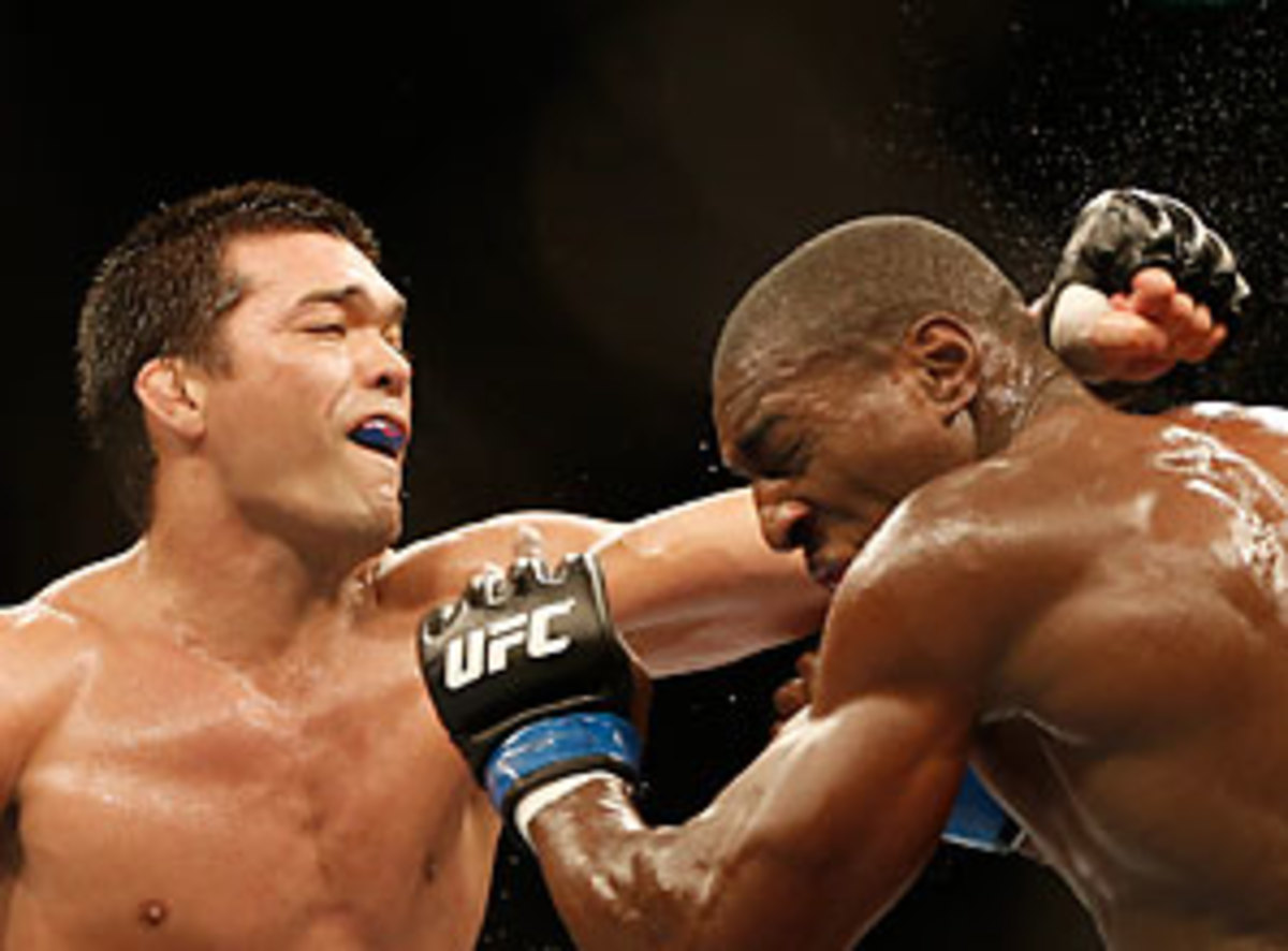 In a decision that upset many in the crowd at UFC 163 Phil Davis (right) won a decision over Lyoto Machida.