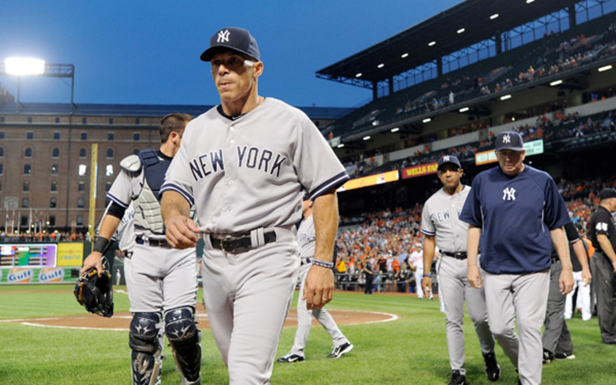 Joe Girardi expects to be back with the Yankees next season. (Greg Fiume/Getty Images)