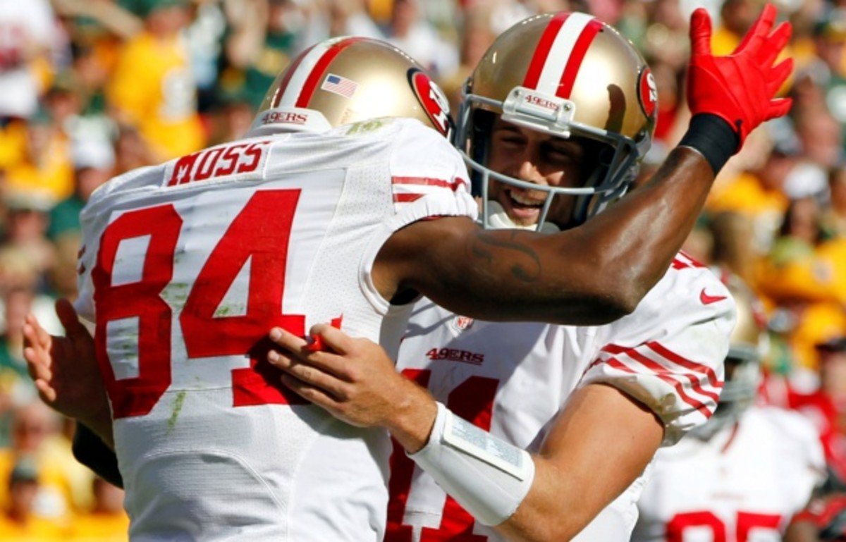The 49ers' first touchdown of the 2012 season came on a pass from Alex Smith to Randy Moss. (Mike Roemer/AP)