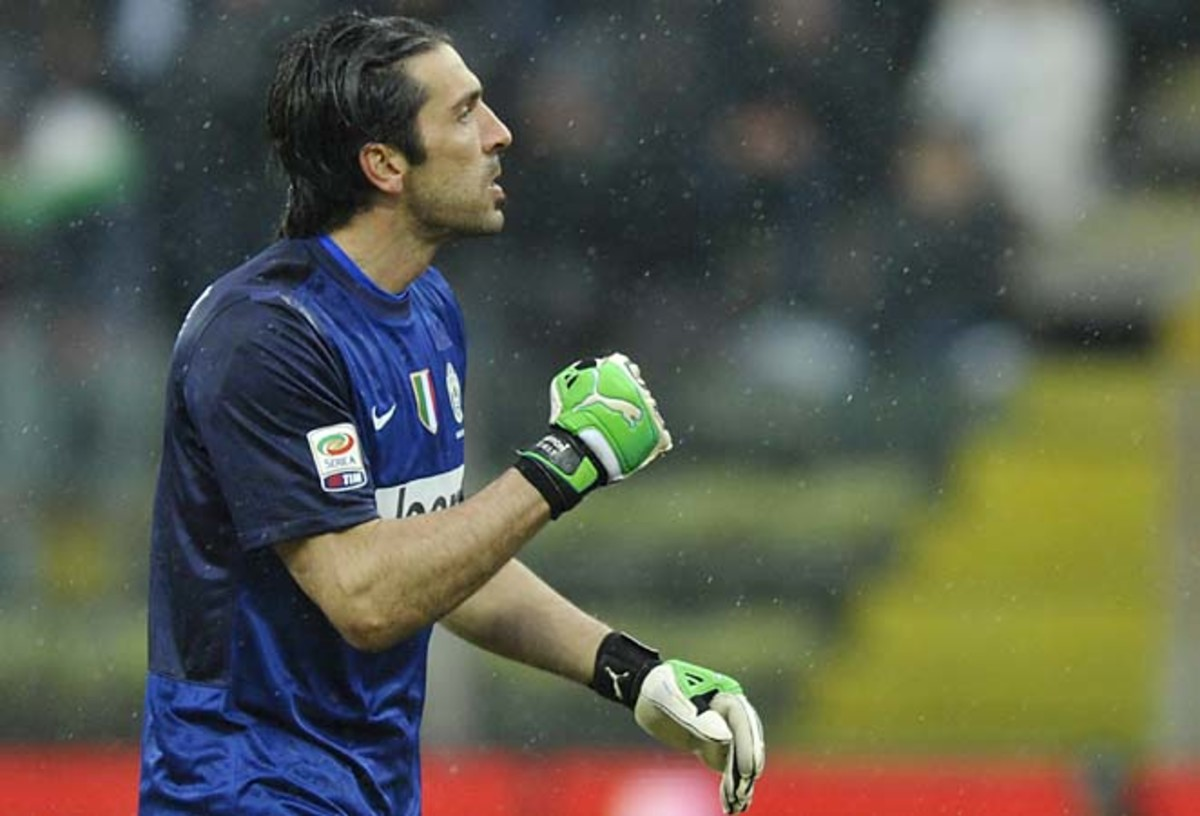 Gianliugi Buffon and Juventus lead Serie A by five points over Napoli and Lazio.