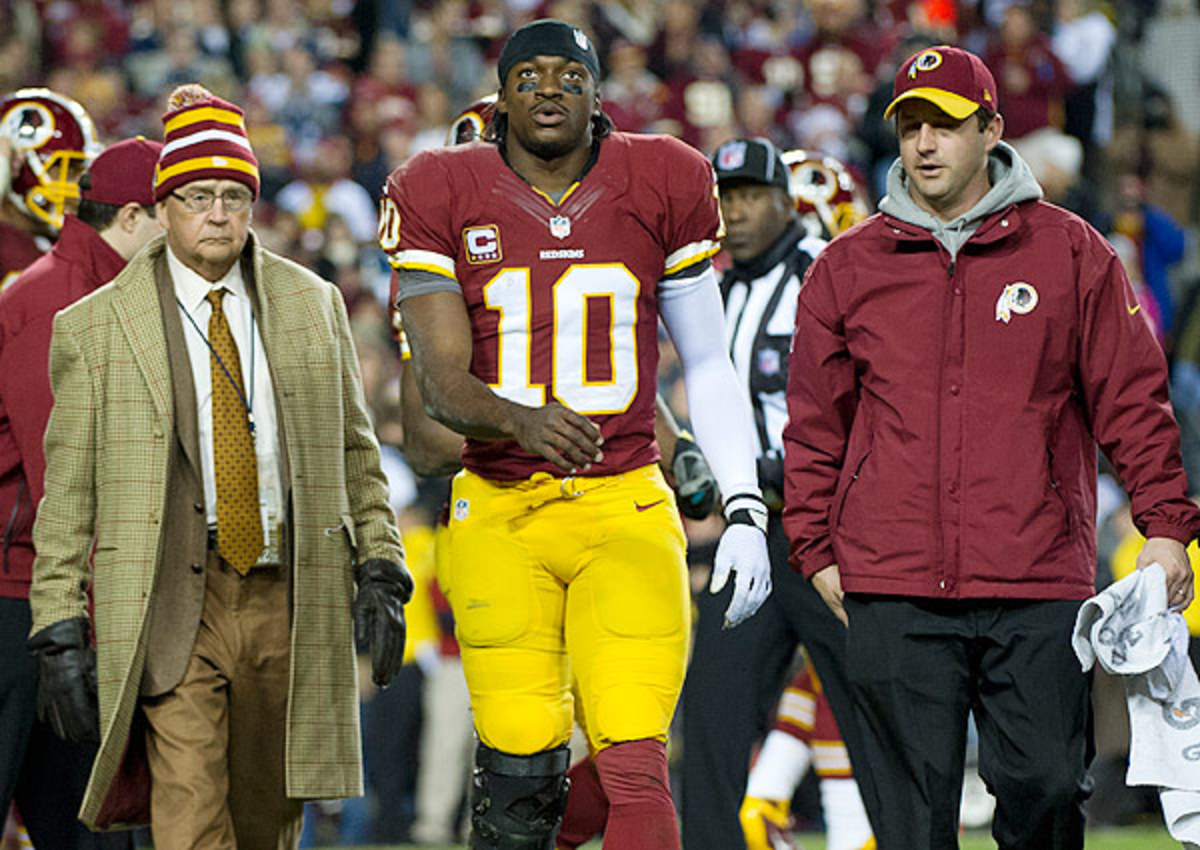 Dr. James Andrews (left) cleared Robert Griffin III to play, only to express concerns about his usage.