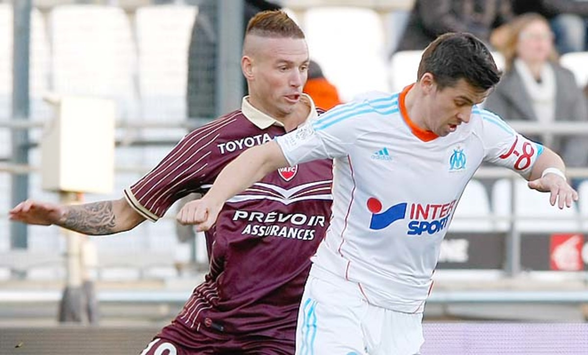 Joey Barton (right) and Marseille are in third place, five points behind PSG in Ligue 1.