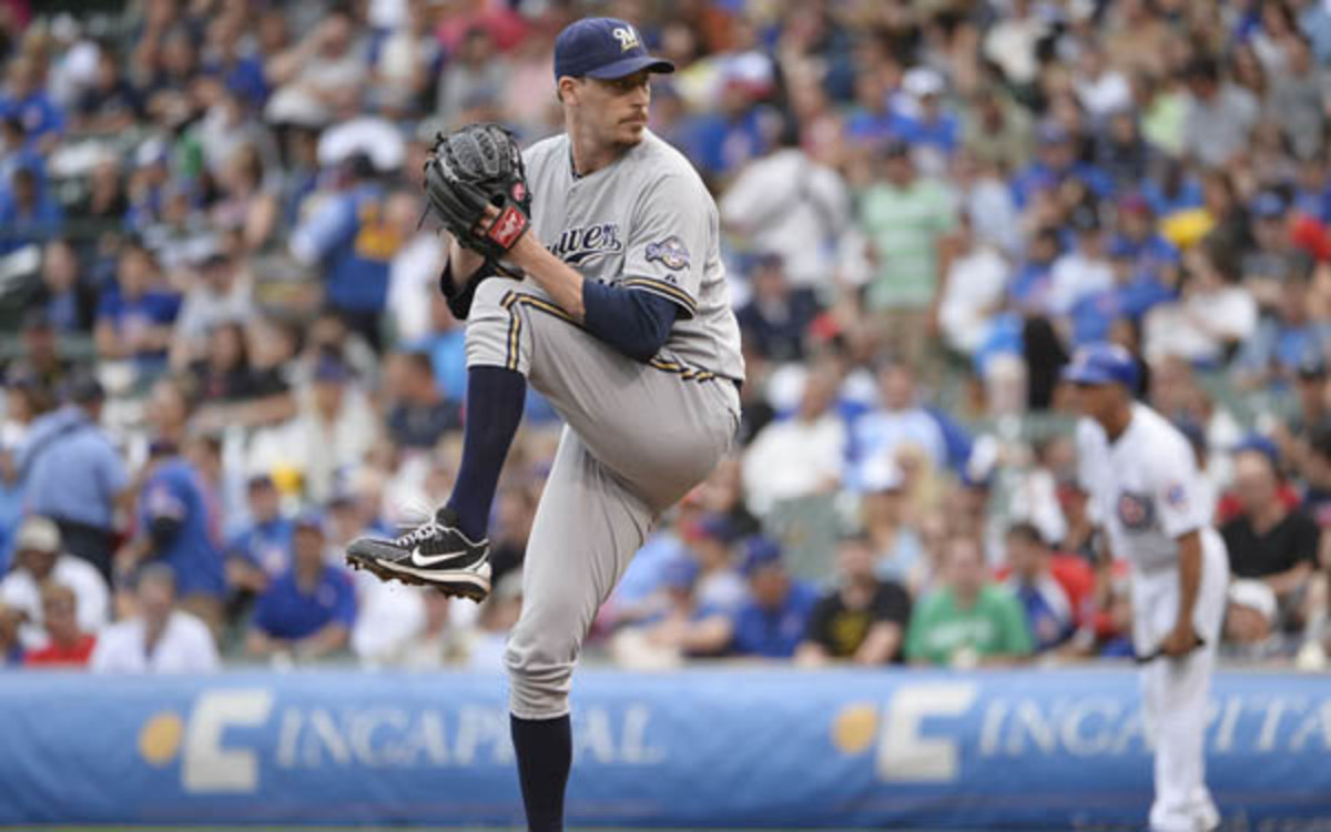 Reliever John Axford was traded from the Brewers to the Cardinals. (Brian D. Kersey/Getty Images)