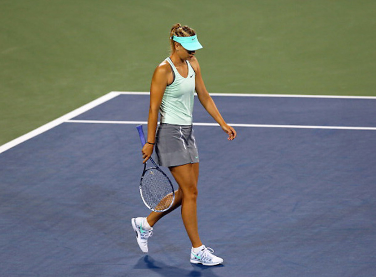 Maria Sharapova's tumultuous summer will conclude with her withdrawal from the U.S. Open. [Ronald Martinez/Getty Images]