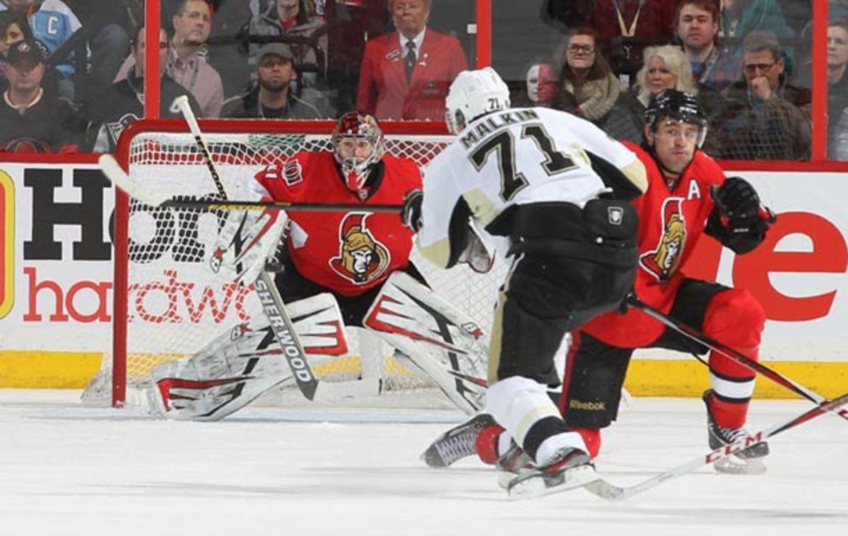 Craig Anderson of the Ottawa Senators and Evgeni Malkin of the Pittsburgh Penguins
