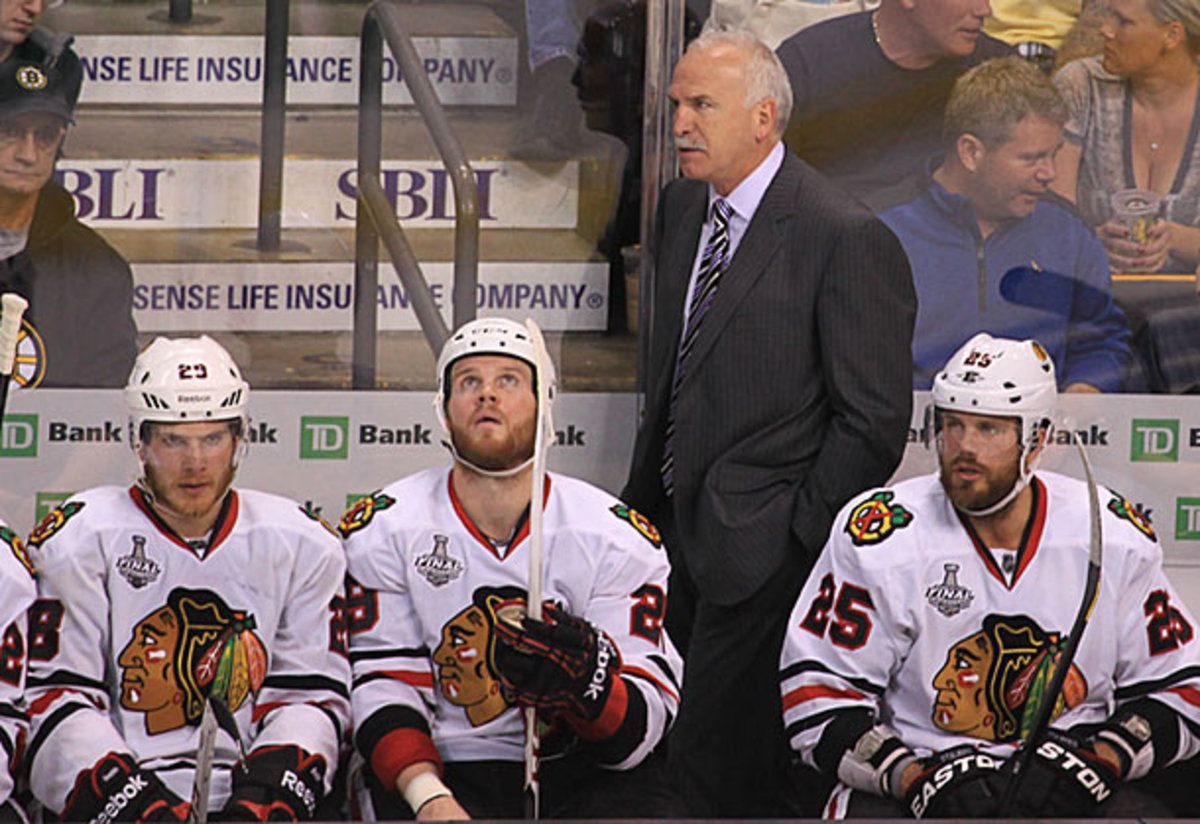 The Blackhawks look on during their Game 3 loss in the Stanley Cup Final.