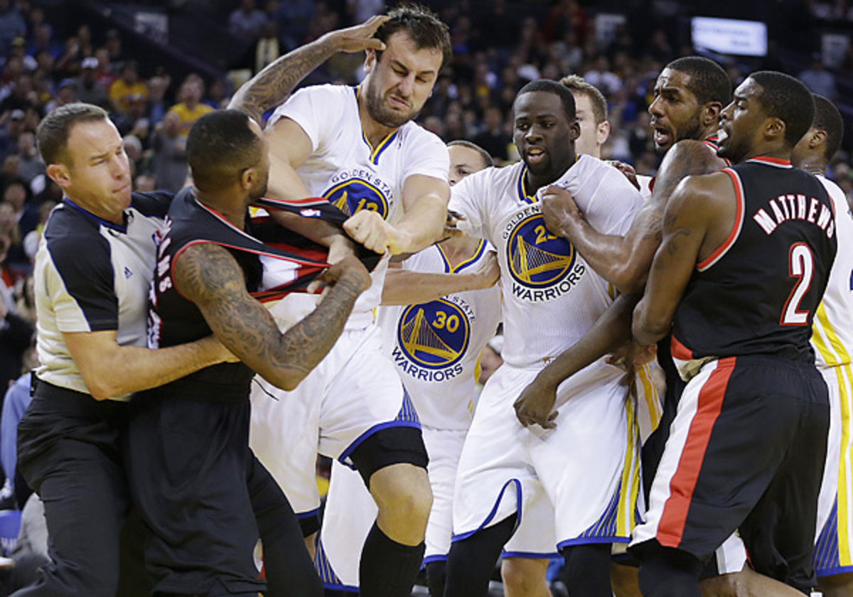 The Blazers and Warriors got into an on-court scuffle Saturday night that saw three players ejected. (Ben Margot/AP)