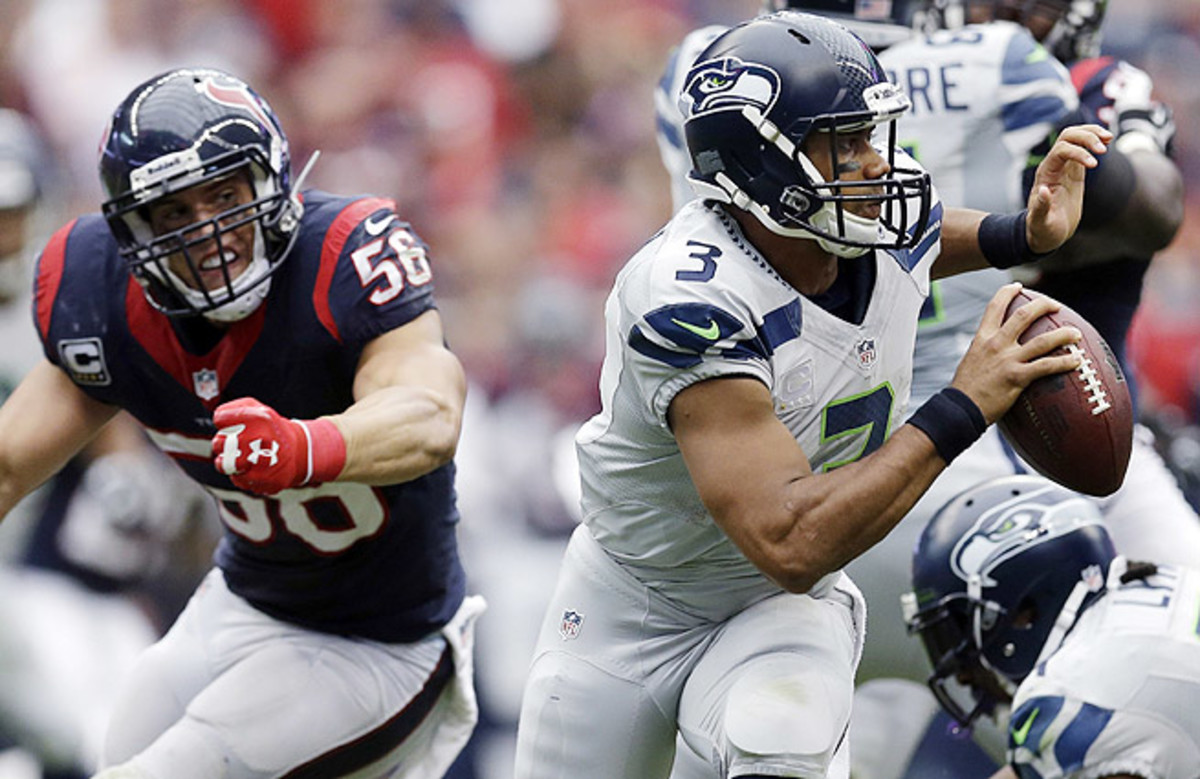Russell Wilson (right) and the Seahawks have now won five of their last six games on the road.