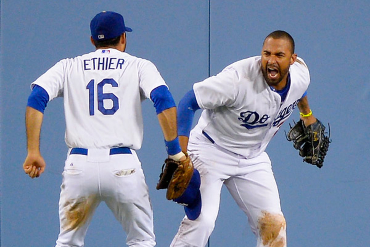 Matt Kemp celebrates with Andre Ethier after making a game-saving catch against the Giants on Tuesday night. (AP)