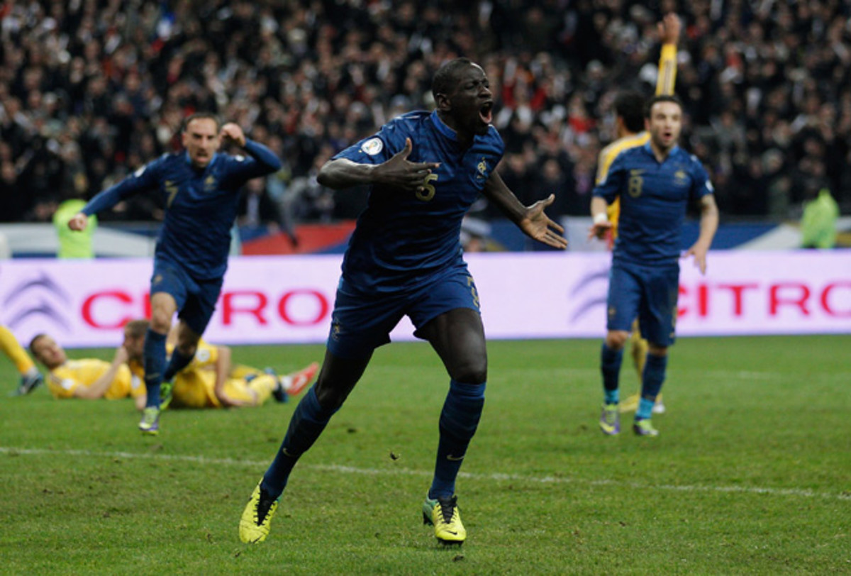 Mamadou Sakho celebrates after the goal that put France in the World Cup, with Les Bleus completing a comeback from a 2-0 deficit to Ukraine.