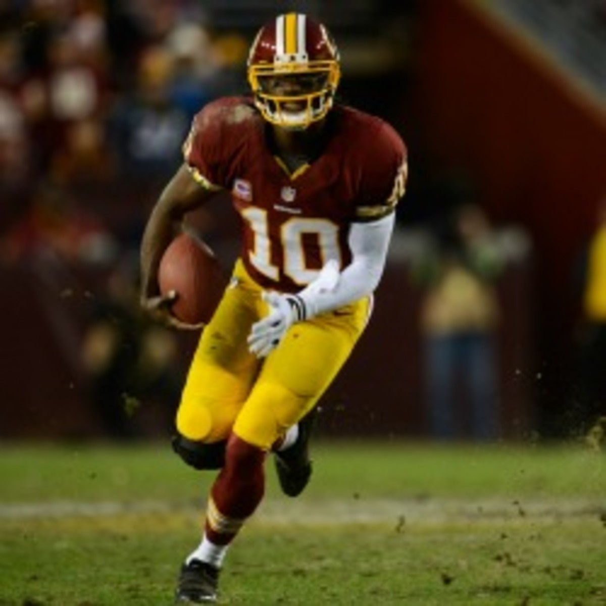 "Dr. James Andrew said Friday that RGIII is ""way ahead of schedule"" with his knee rehabilitation. (Patrick McDermott/Getty Images)"