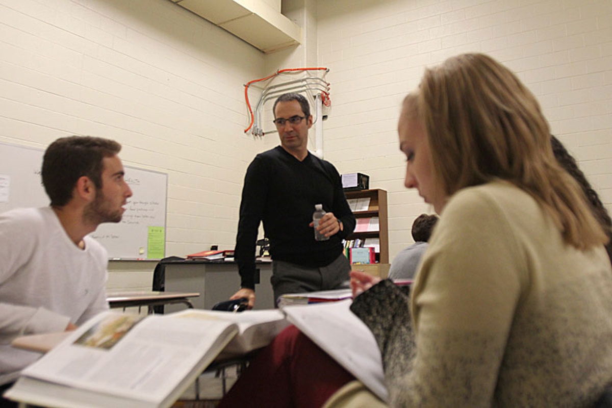 Paganelli in his AP History class at Wyoming High in Michigan. His students, he says, can be tougher on him after games than NFL players are.