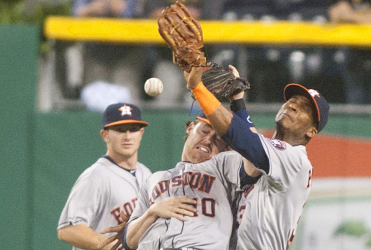 The Astros' winning percentage puts them on pace to be the worst team since the 1962 New York Mets. (Vincent Pugliese/Getty Images)