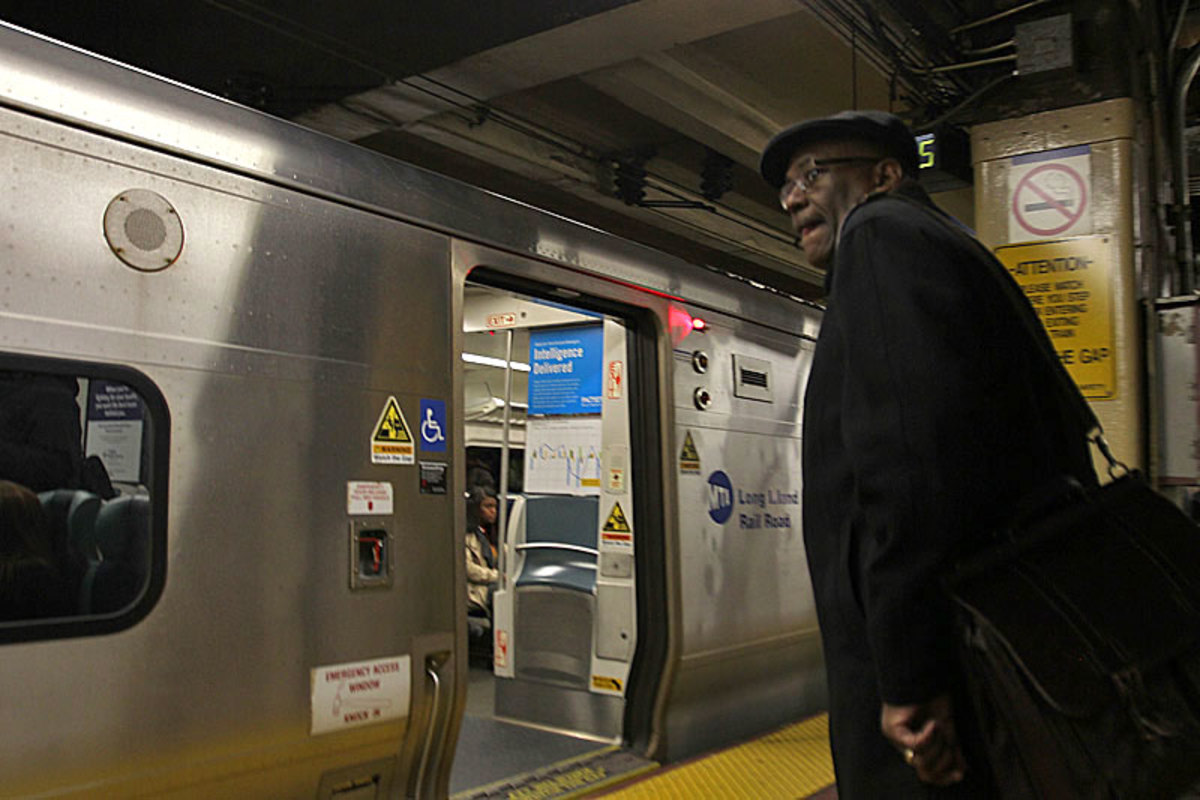 Wayne Mackie boards a commuter train headed home from his day job working on housing issues in New York City. He's got Bears and Ravens video waiting for him.