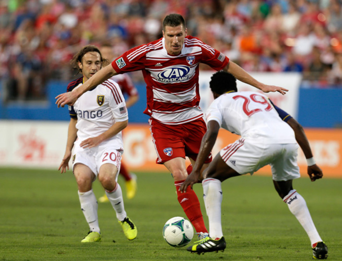 Forward Kenny Cooper, center, will be suiting up for the Seattle Sounders next season after agreeing to terms on a contract with the club.