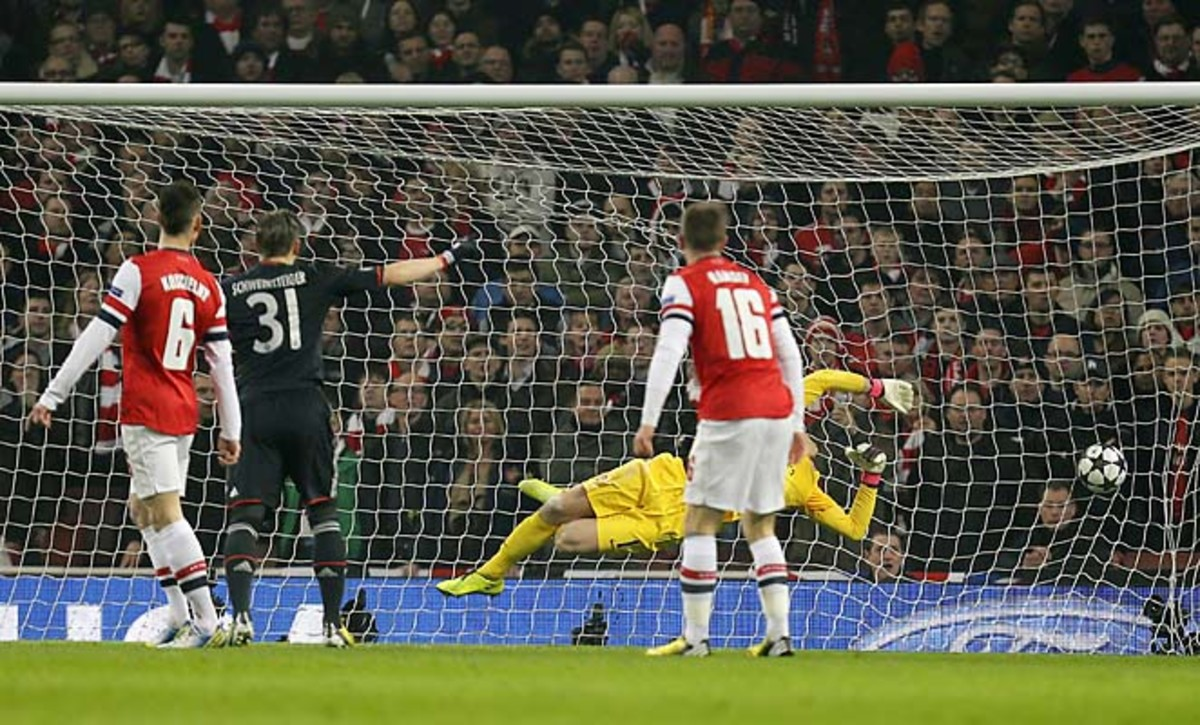 Bastian Schweinsteiger watches as Toni Kroos' shot goes past Arsenal keeper Wojciech Szczesny.