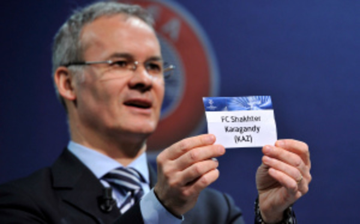 UEFA Competition Director Giorgio Marchetti holds the card for FC Shakhter Karagandy during a Champions League qualifying round in Switzerland earlier this summer. The Kazakh team was warned this week by the UEFA for its ritual animal slaughter before games. (Harold Cunningham/Getty Images)