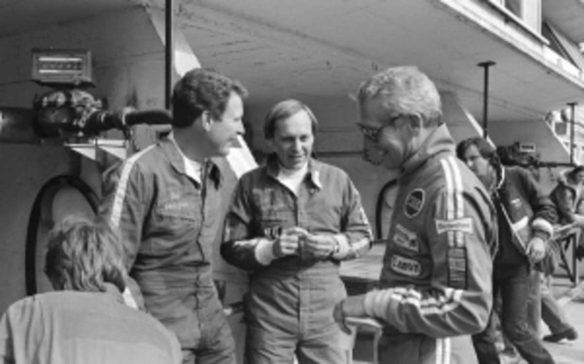 Don and Bill Whittington chat with film star Paul Newman during their 1979 win at France's 24-hour Le Mans. The brothers used a Porsche 935 Turbo for the race. (AP Photo/Bodini)