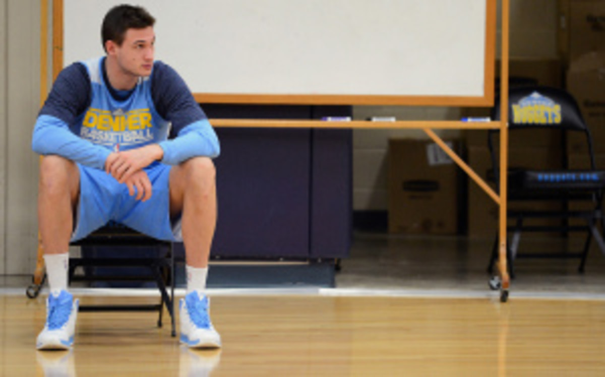 Danilo Gallinari looks to return to the Nuggets at the end of November. In April, he tore his ACL in a game against the Dallas Mavericks. (Garrett Ellwood/Getty Images)
