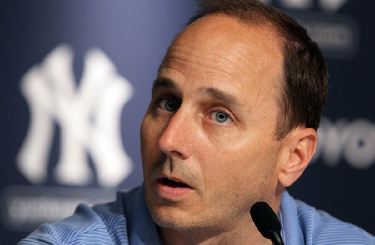 Brian Cashman has challenged Alex Rodriguez to find a doctor to examine his sore quadriceps muscle.