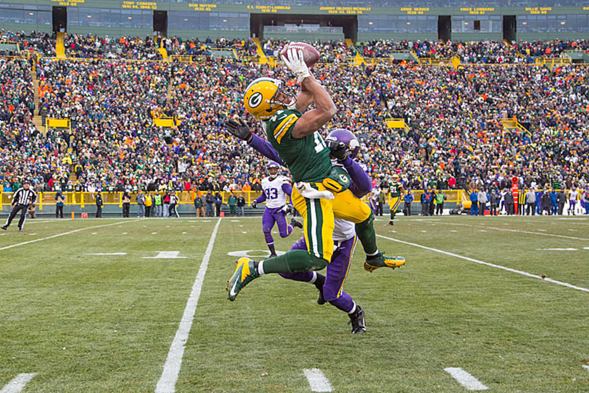 Late against the Vikings, Flynn began clicking with receivers such as Jarrett Boykin, who caught a long pass to set up the Pack's field goal in overtime. (Tom Lynn/Getty Images)