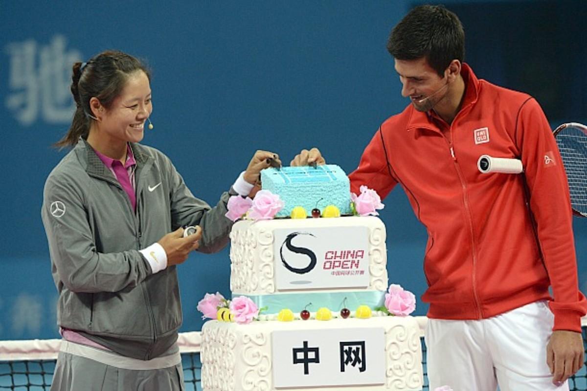 Li Na and Novak Djokovic help cut the cake to celebrate the China Open's 10th anniversary. (Goh Chai Hin/AFP/Getty Images)