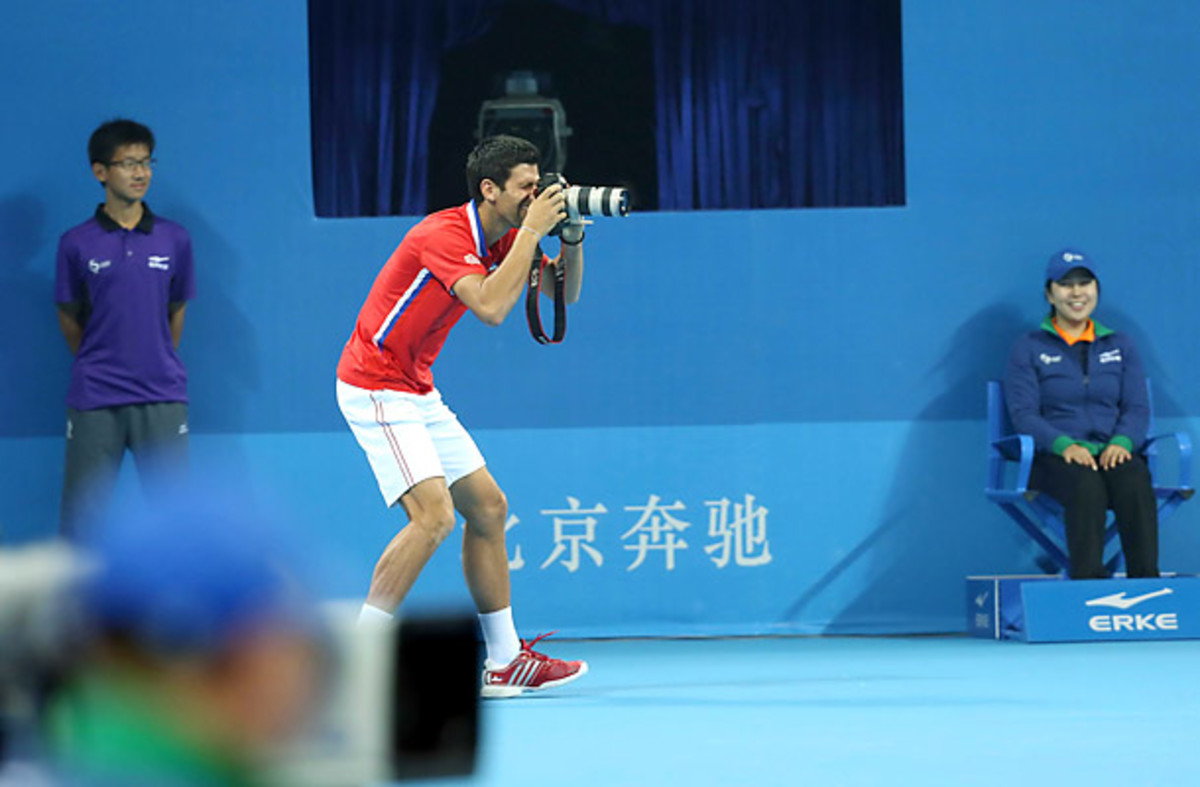 Djokovic moves to the other side of the lens.