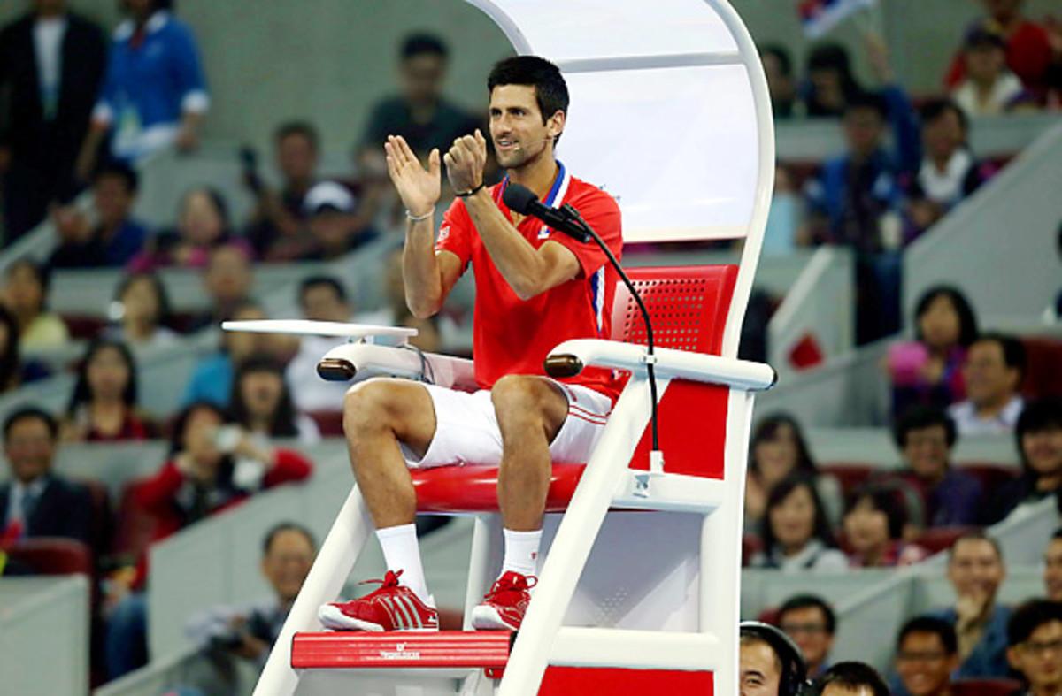 Novak Djokovic plays umpire in his charity match against Li Na.