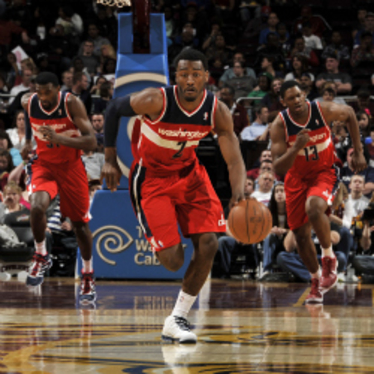 John Wall thinks he's the NBA's fastest player; he considered Russell Westbrook, Derrick Rose, Mike Conley and Ty Lawson to be quick also. (David Liam Kyle/Getty Images)