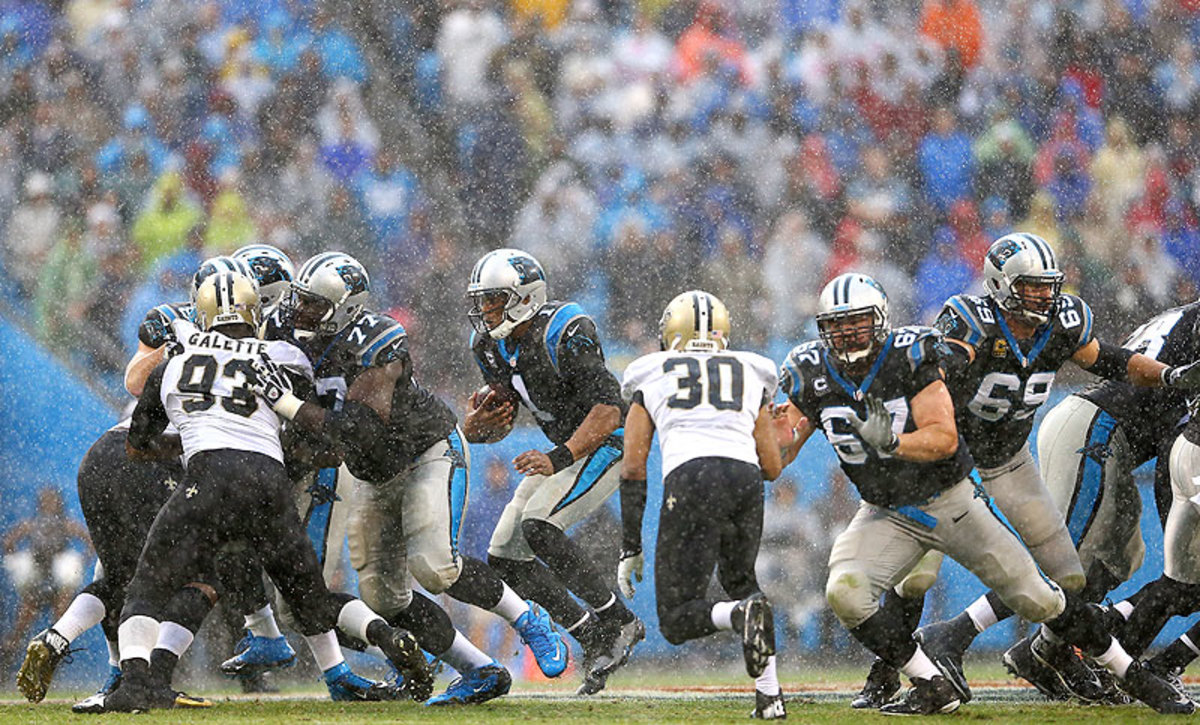 For 59 minutes against the Saints, the performance of Cam Newton and the Carolina Panthers offense mirrored the conditions at Bank of America Stadium: a mess. (Streeter Lecka/Getty Images)