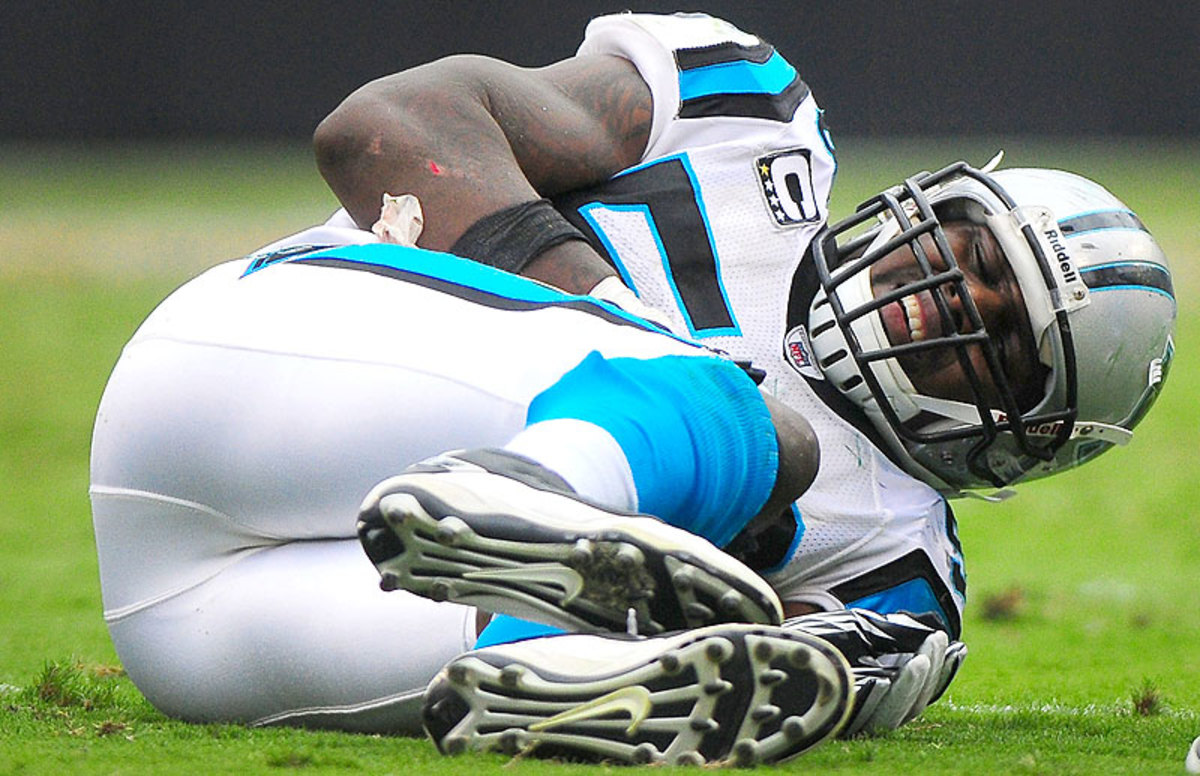 Panthers linebacker Thomas Davis suffered three torn ACLs in four years, the last coming at the beginning of the 2011 season. He came back from each and is now having his best season as a pro. (Jeff Siner/Getty Images)