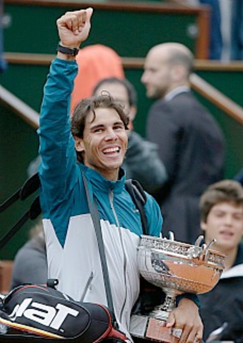 Nadal salutes the crowd. (Kenzo Tribouillard/AFP/Getty Images)