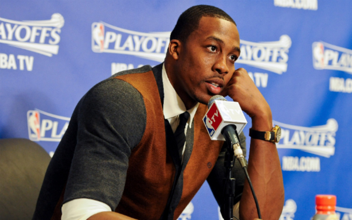 Dwight Howard is reportedly interested in signing with the Rockets and Mavericks this offseason. (Andrew D. Bernstein/Getty Images)