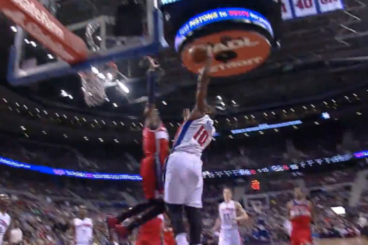 Greg Monroe extends for a dunk over John Wall. (NBA on YouTube)