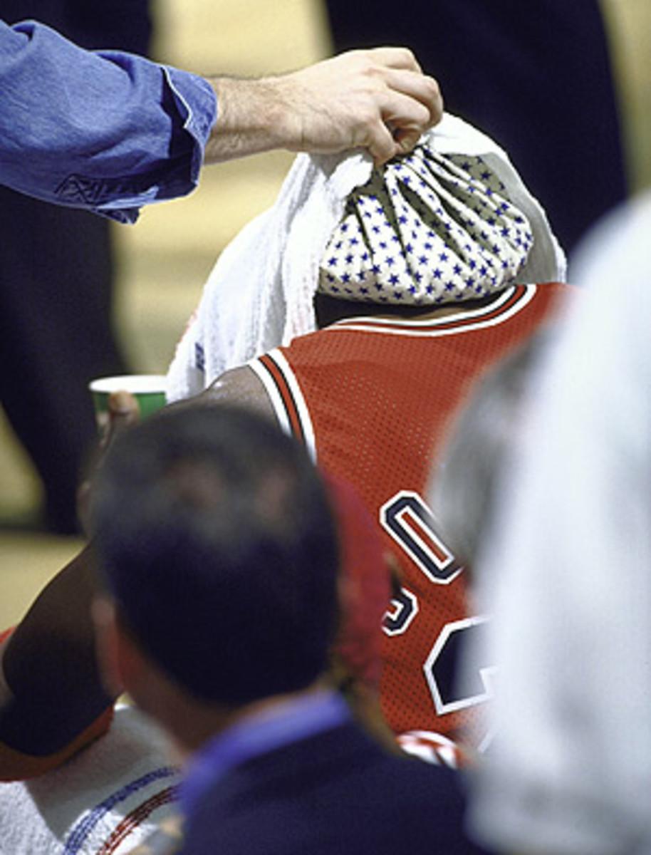 Michael Jordan receives treatment on the sidelines