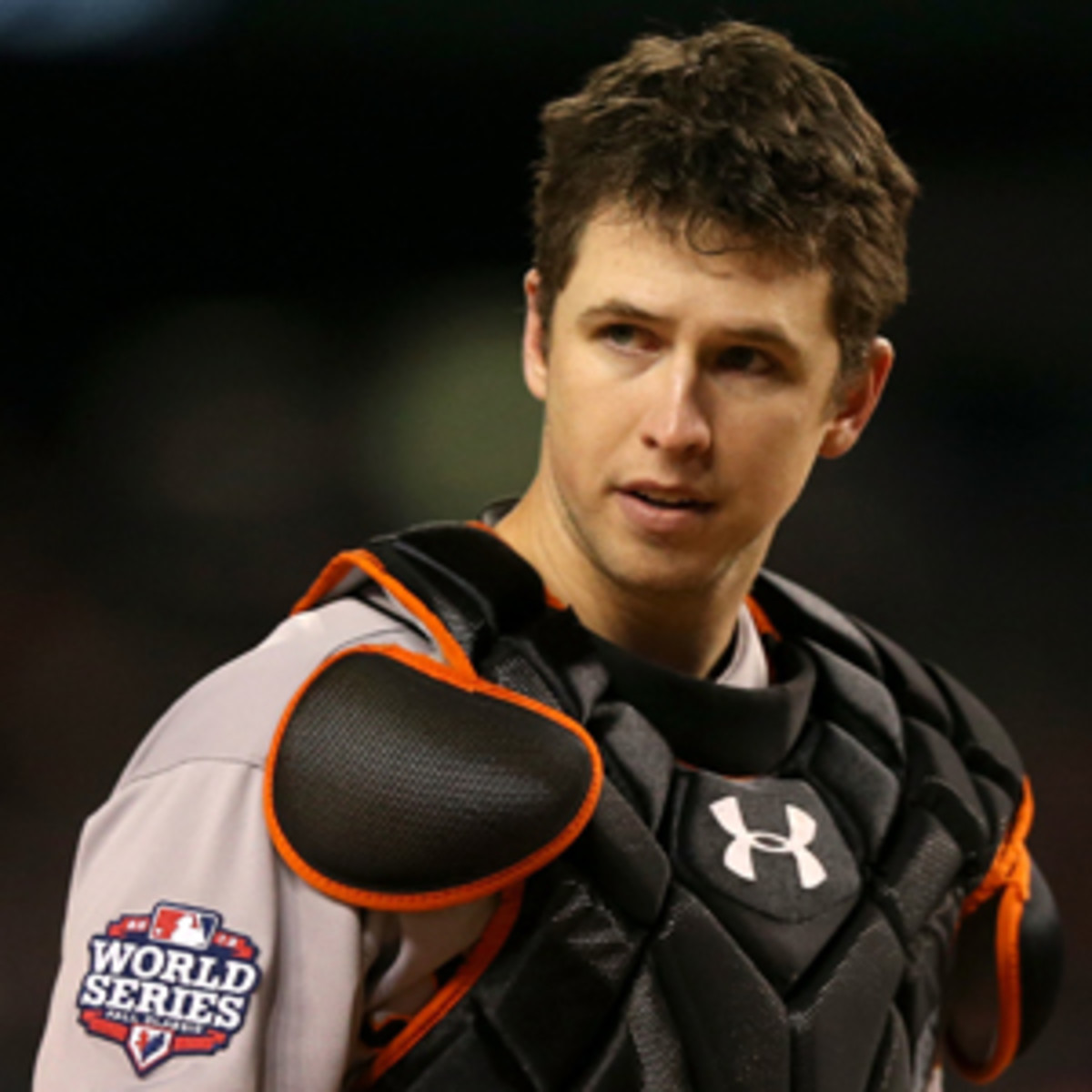 Buster Posey, the 2013 NL MVP, is scheduled to become a free agent after the 2016 season. (Ezra Shaw/Getty Images)